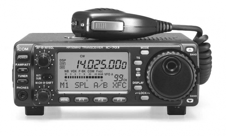 Front view of IC703 with microphone resting on top. The radio is tuned to 14.025mhz