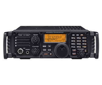 A picture of the Icom IC-7200.  The display is reading 7.072.  This model has the carry handles attached.