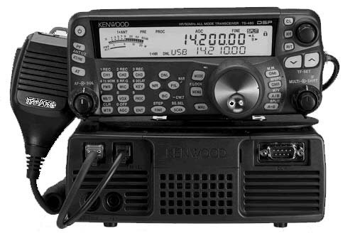 Image of the Kenwood Ts-480. The face plate is sat on top of the radio body. The microphone is to the left of the body. The radio is tuned to 14.200mhz.